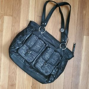 The Sak medium black tote  15x12x5 with 6 pockets.